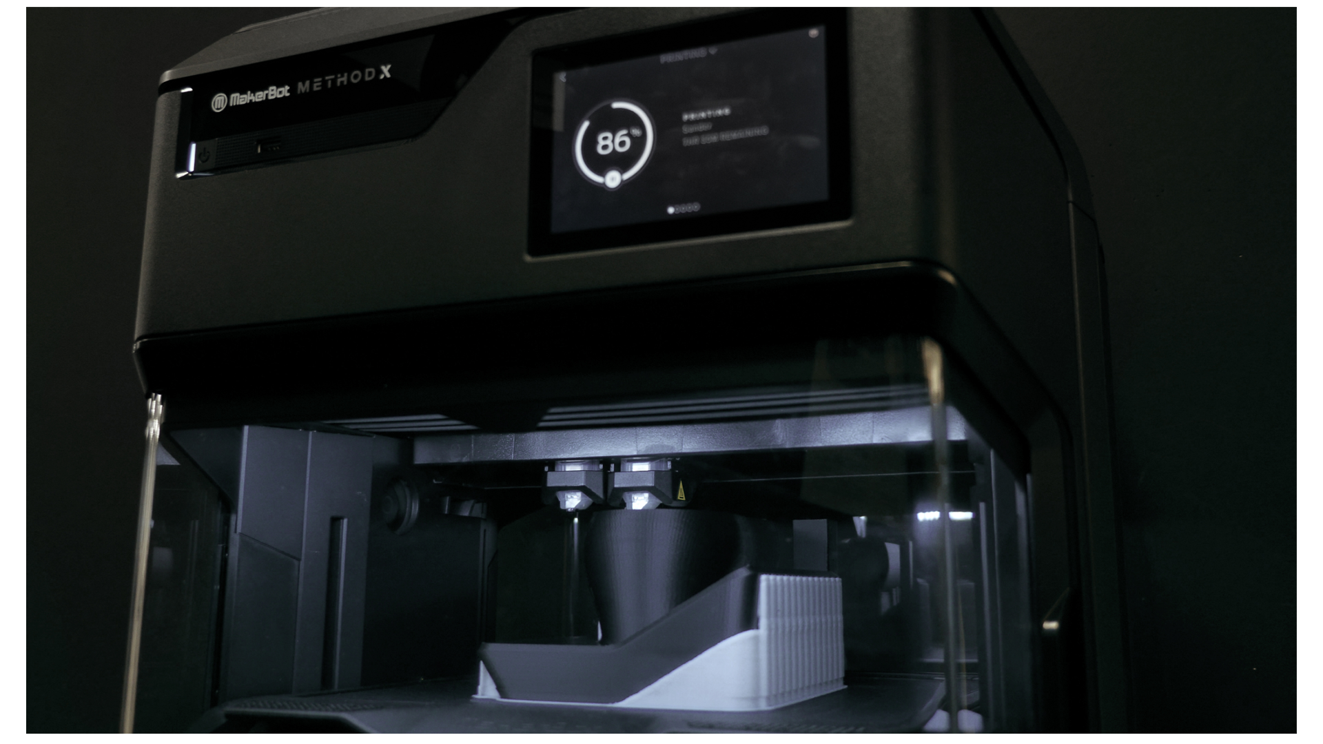 The MakerBot METHOD uses dual extruders to print dissolvable support material underneath the model.